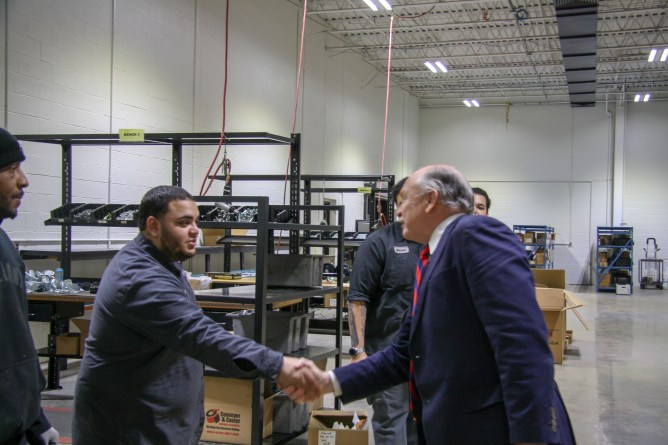 Angel Sanchez greets Mayor Clough