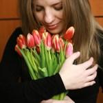 Lady holding fresh flowers