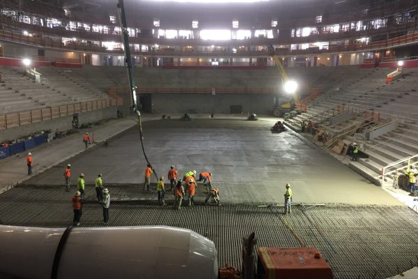 11workers lay down concrete grid at Little Caesars Arena