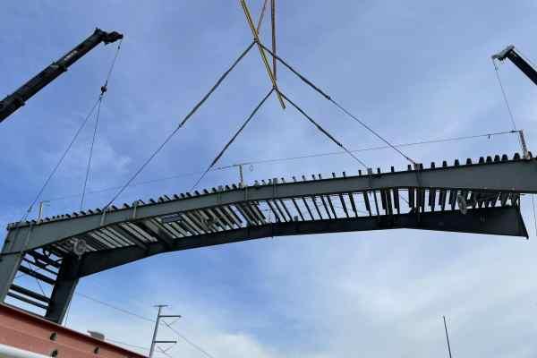 11Kiewit Power metal frame lifted by crane