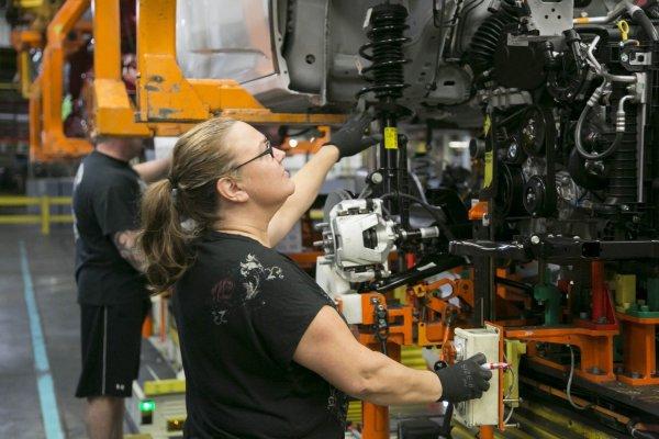 11woman operates assembly plant machine