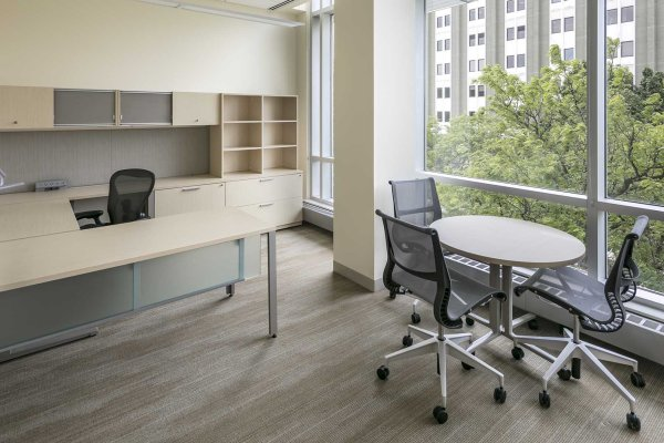 11office interior with desk, table, and large windows