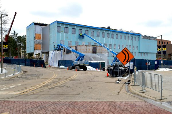 UM Murchie Hall exterior with blue lifts