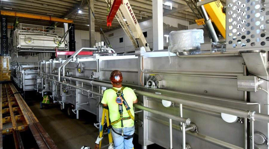 Spartan Dairy Plant worker on ladder