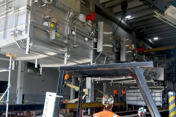 Spartan Dairy Plant workers install machinery