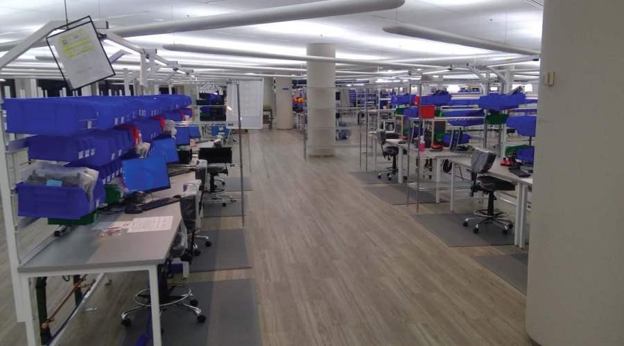 office interior with desks and storage bins