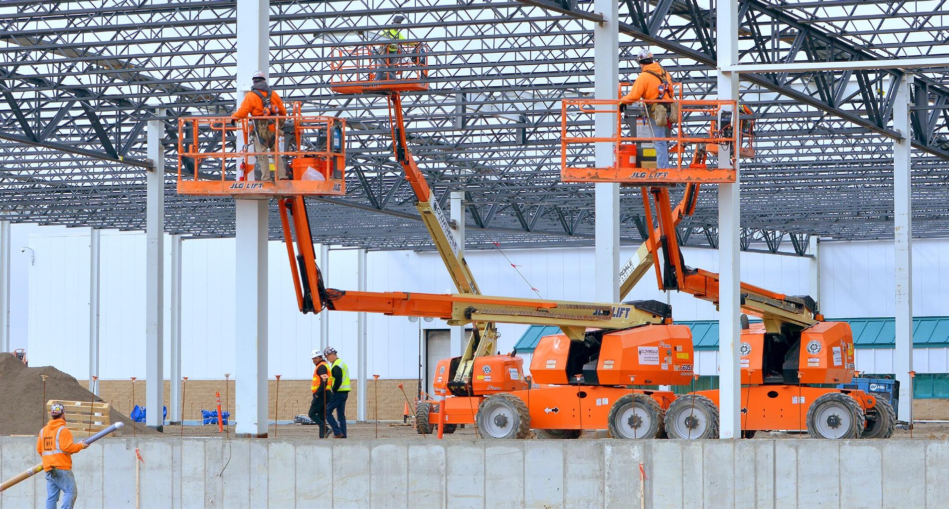 construction men on orange skyjacks