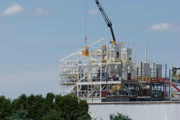 11construction crane hoisting yellow box