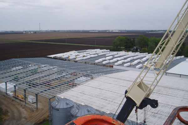 overhead view of barns and silos with crane