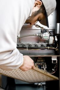 a service technician works on hvac and plumbing on charleston afb
