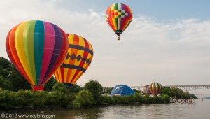 Balloons taking flight at the Hudson River Rowing Association Boathouse along the Hudson River during the Dutchess County Regional Chamber of Commerce's Balloon Festival in Poughkeepsie, NY. (July 7, 2012)