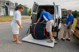 Matthew McClinton loads the packed balloon into the company van after the morning flight in Poughkeepsie, NY. (July 7, 2012)