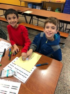 3rd graders learning coding with Ozobots