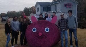 CHS FFA students at the Flying Pig beside their VA State Fair Hay Bale competition entry