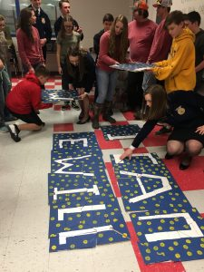 students putting together a puzzle