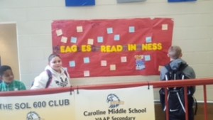 students hanging kindness sign