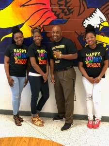 three teachers and assistant principal with last day of school shirts