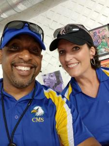 Two Middle School administrators at county fair smiling