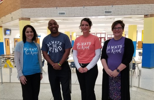 administrative staff with kindness shirts