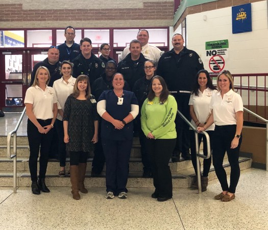 group of adults who taught CPR to students