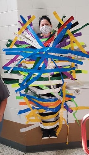Mrs. Griggs gets taped to the wall.