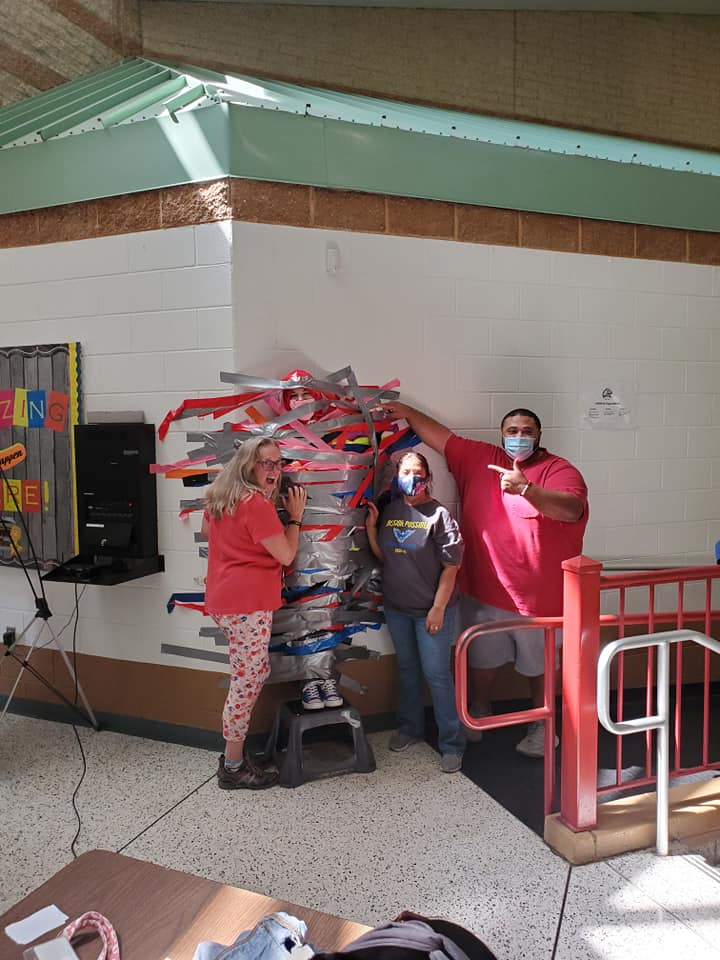 Mrs. Tucholski gets taped to the wall