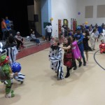 kids dancing at a school dance in costumes
