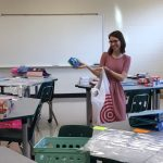 Teacher holding supplies