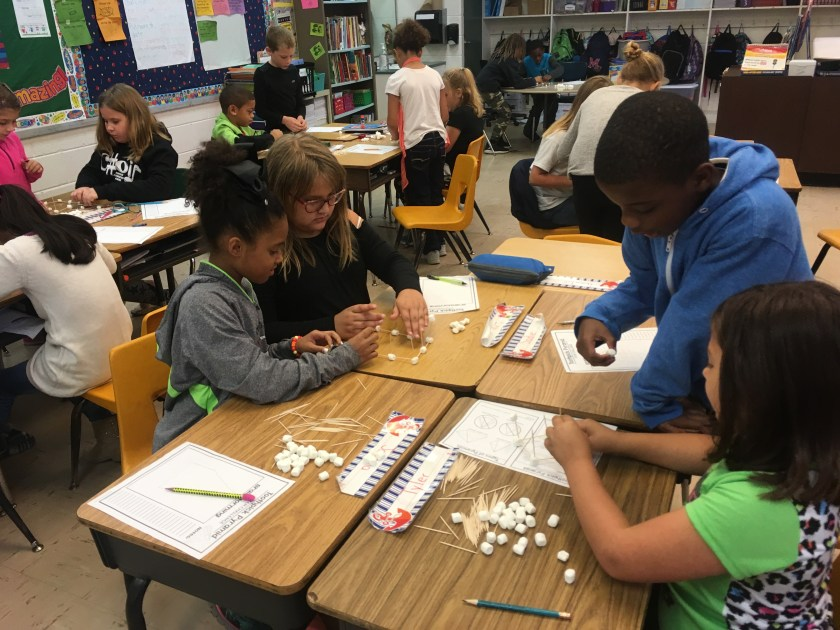 Groups of students working in partners to build a pyramid