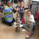 Students sitting on the floor with their tower