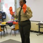 Corrections Officer showing orange shoes