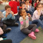 Group of student playing their harmonicas