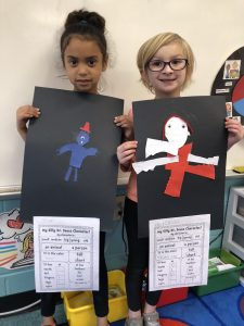 Two students displaying their character designs