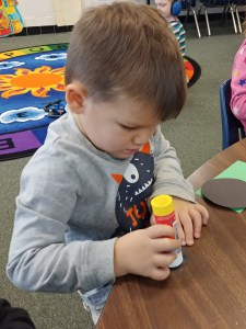 Student gluing shapes