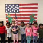 PreK students and an American flag banner