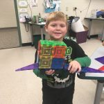 student shows his creation