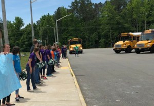 Teachers bidding farewell to the buses