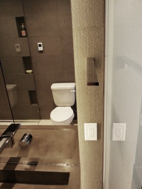 Low profile towel bar and outlet after renovation