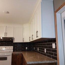 New backsplash, cabinets and countertop