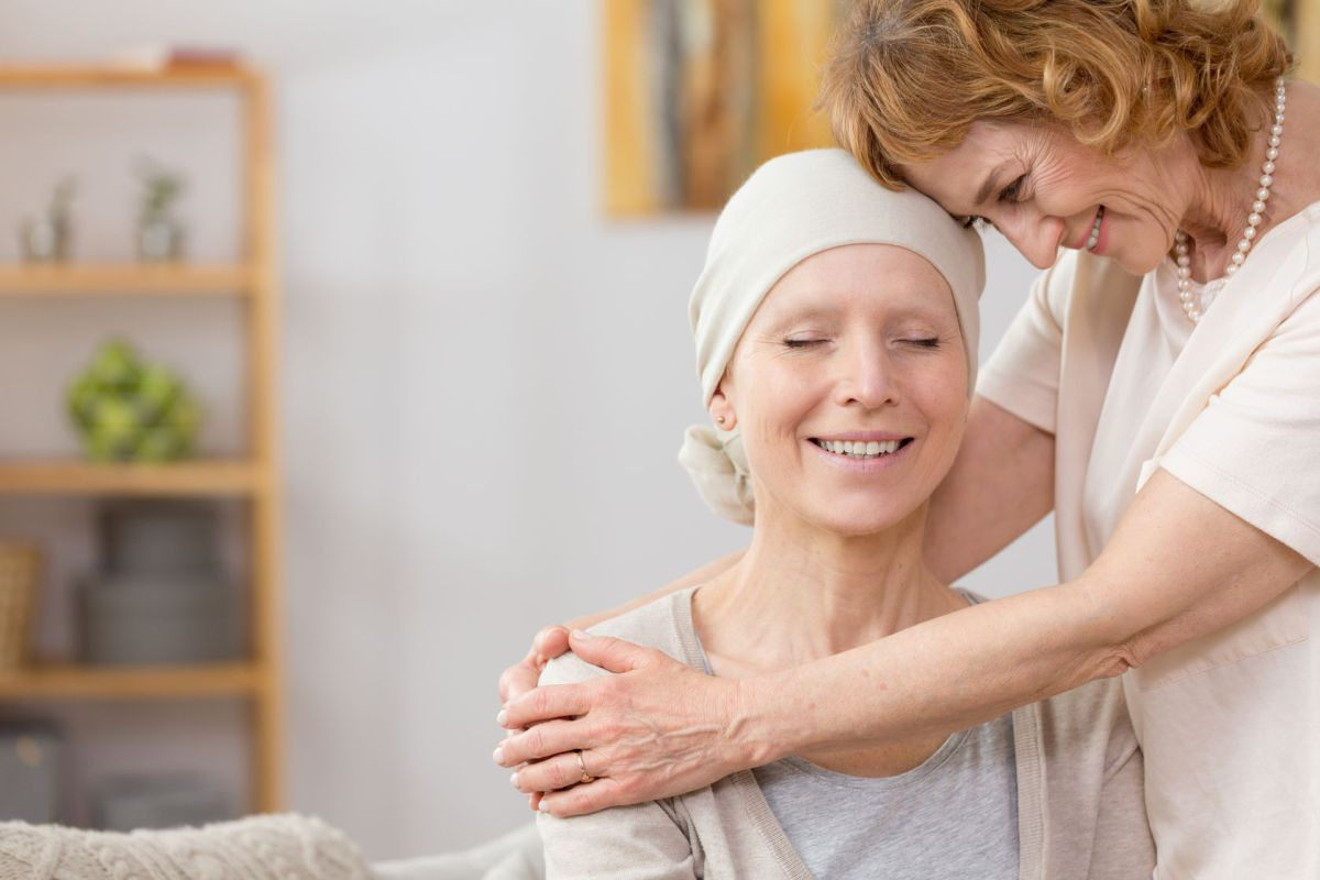 Senior Woman Helping Her Friend Suffering From Cancer