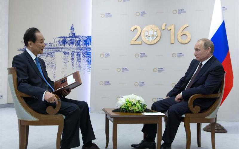Russian President Vladimir Putin (R) is interviewed by President of Xinhua News Agency Cai Mingzhao in St.Petersburg of Russia, June 17, 2016. (Xinhua/Bai Xueqi)
