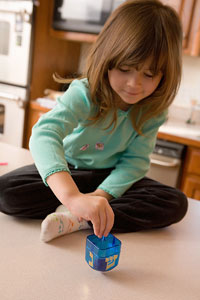 Photo: A girl playing with a toy.