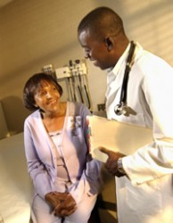 Photo: older woman talking with doctor