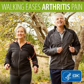 Walking eases arthritis pain. Older man and woman walking outside.