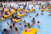 Crowded wavepool with swimmers and inner tubes.