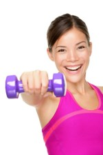 Woman working out with a dumbbell