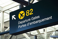 airport sign with arrow pointing to departure gate