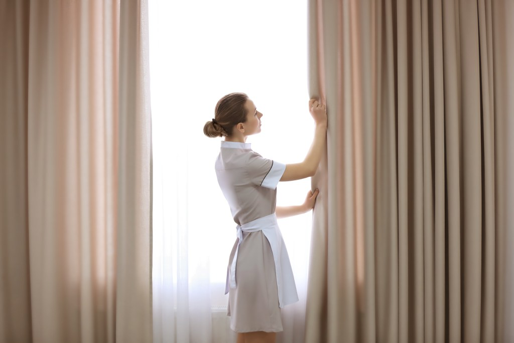 Staff_cleaning_curtains