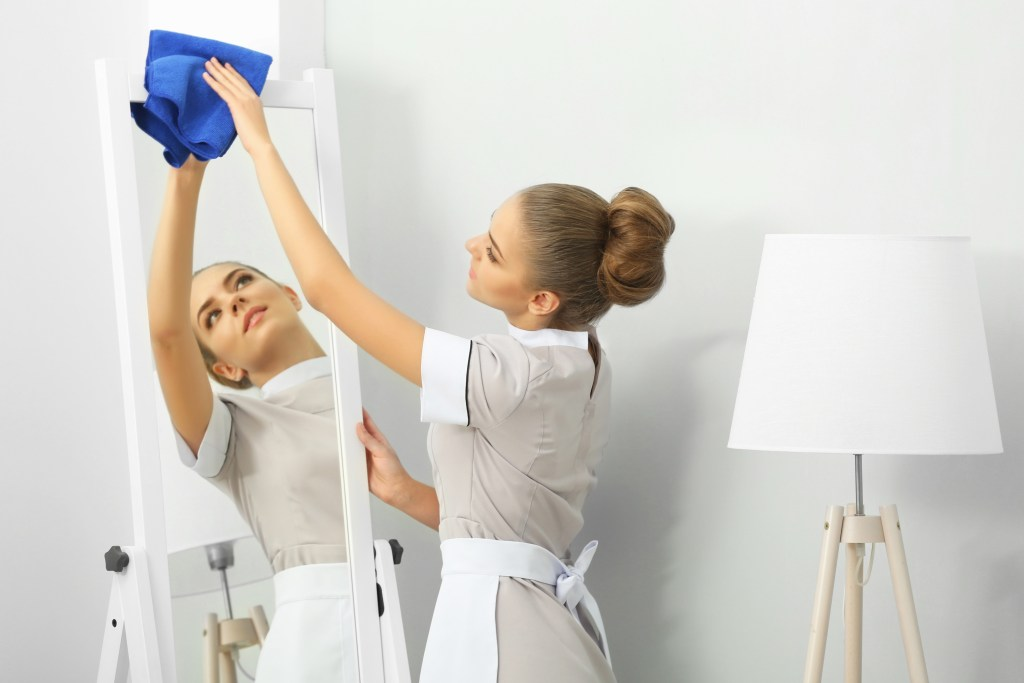 Staff_cleaning_mirror