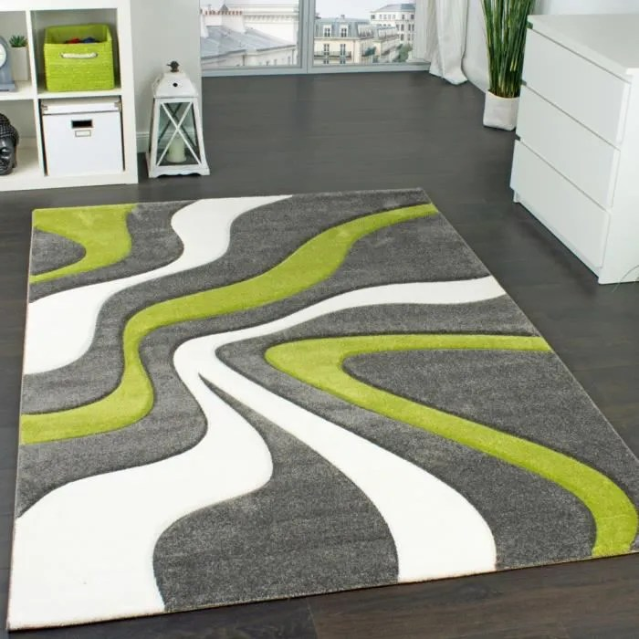 tapis de createur aux contours decoupes motif vagu